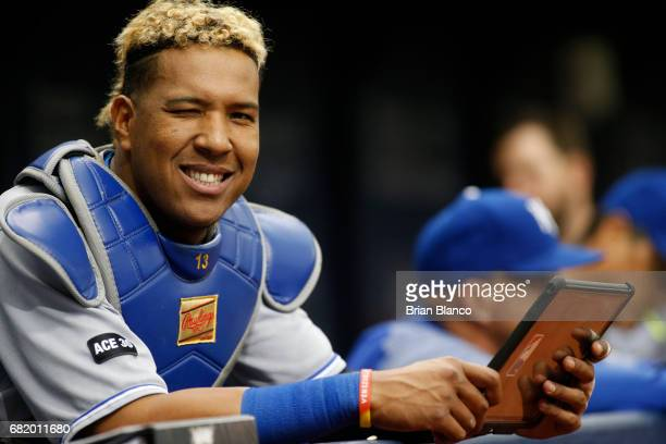 Catcher Salvador Perez of the Kansas City Royals winks as he takes a break from reviewing a tablet in the dugout during the seventh inning of a game...