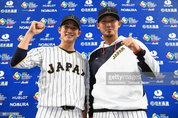 Catcher Seiji Kobayashi and Infielder Sho Nakata of Japan pose for photographs during the interview after their 17 win in the World Baseball Classic...