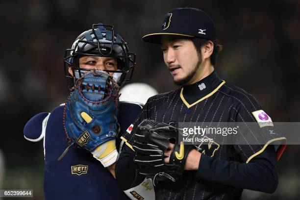 Catcher Seiji Kobayashi and Pitcher Ayumu Ishikawa of Japan talk after the bottom of the second inning during the World Baseball Classic Pool E Game...