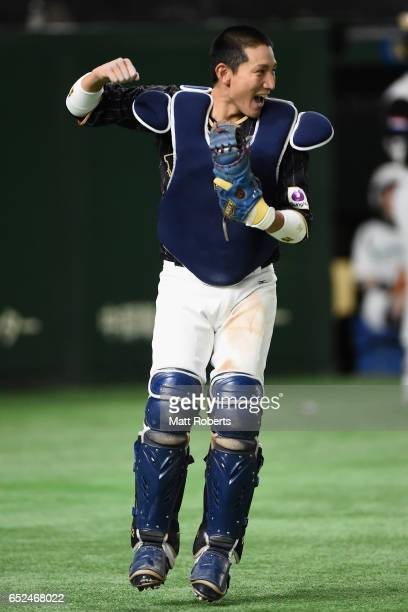 Catcher Seiji Kobayashi of Japan celebrates after catching a pop fly hit by Outfielder Kalian Sams of the Netherlands to win by 86 in the bottom of...