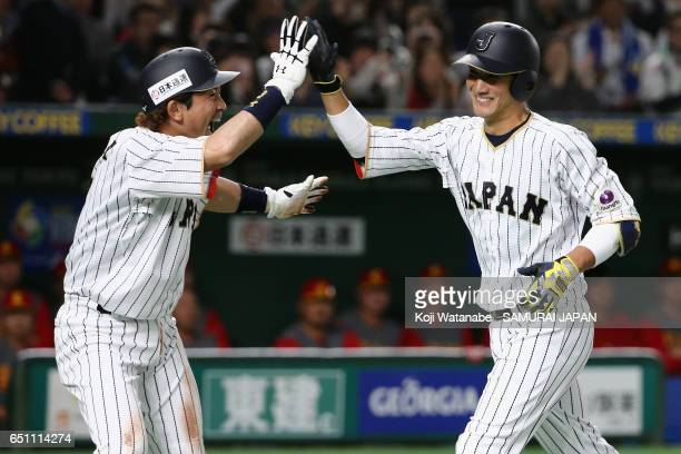 Catcher Seiji Kobayashi of Japan celebrates with his team mate Infielder Nobuhiro Matsuda after hitting a two run homer in the bottom of the second...
