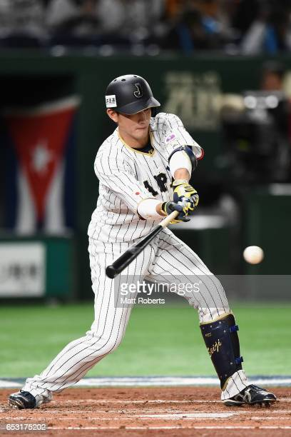 Catcher Seiji Kobayashi of Japan grounds out in the bottom of the second inning during the World Baseball Classic Pool E Game Four between Cuba and...