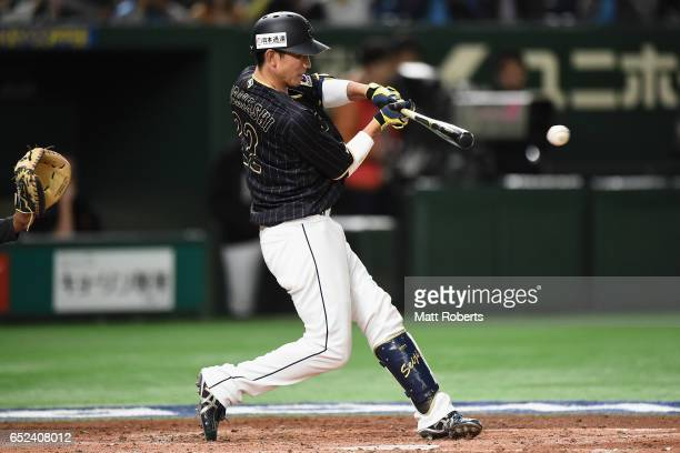 Catcher Seiji Kobayashi of Japan grounds out in the top of the third inning during the World Baseball Classic Pool E Game Two between Japan and...