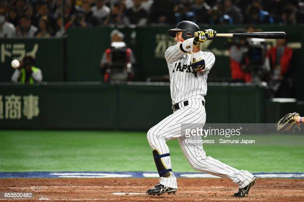 Catcher Seiji Kobayashi of Japan hits a RBI single to make it 03 in the bottom of the sixth inning during the World Baseball Classic Pool E Game Six...