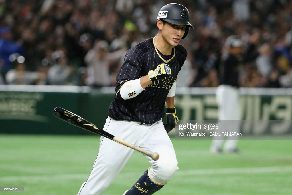 Catcher Seiji Kobayashi #22 of Japan hits a RBI single to make it 6-5 in the top of the fifth inning during the World Baseball Classic Pool E Game Two between Japan and Netherlands at the Tokyo Dome on March 12, 2017 in Tokyo, Japan.