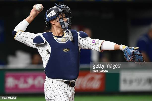 Catcher Seiji Kobayashi of Japan in action in the top of the fourth inning during the World Baseball Classic Pool E Game Six between Israel and Japan...