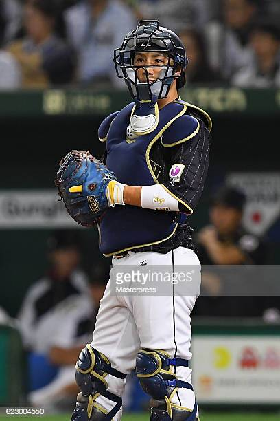 Catcher Seiji Kobayashi of Japan looks on in the eighth inning during the international friendly match between Netherlands and Japan at the Tokyo...