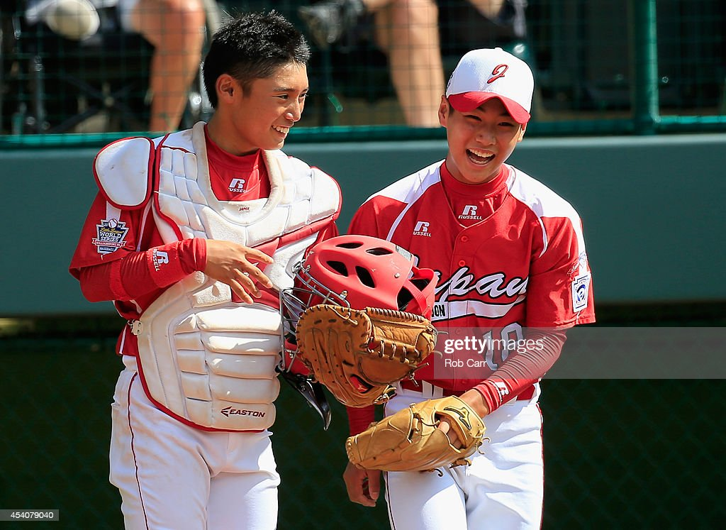Catcher Shingo Tomita #8 and Pitcher Takuma Takahashi #18 of Team Japan share a laugh against the West Team from Las Vegas, Nevada during fourth inning of the Little League World Series third place game at Lamade Stadium on August 24, 2014 in South Williamsport, Pennsylvania.