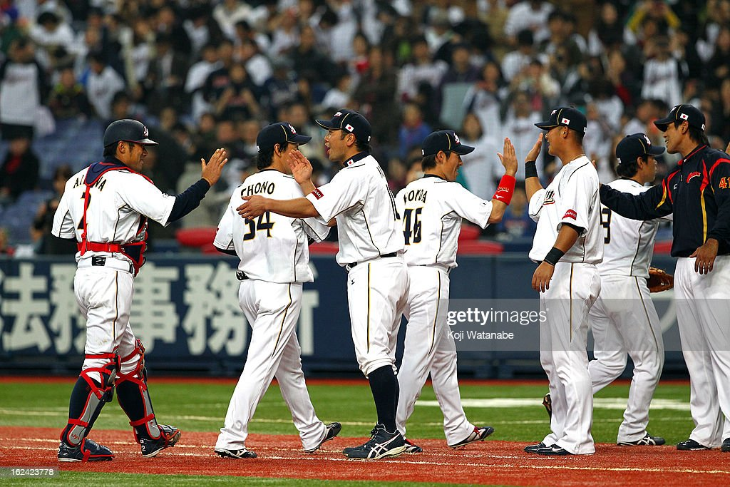 Catcher <a gi-track='captionPersonalityLinkClicked' href=/galleries/search?phrase=Shinnosuke+Abe&family=editorial&specificpeople=2708810 ng-click='$event.stopPropagation()'>Shinnosuke Abe</a> #10 and Catcher Ryoji Aikawa #2 of Japan celebrates with team mates after defeating international friendly game between Japan and Australia at Kyocera Dome Osaka on February 23, 2013 in Osaka, Japan.