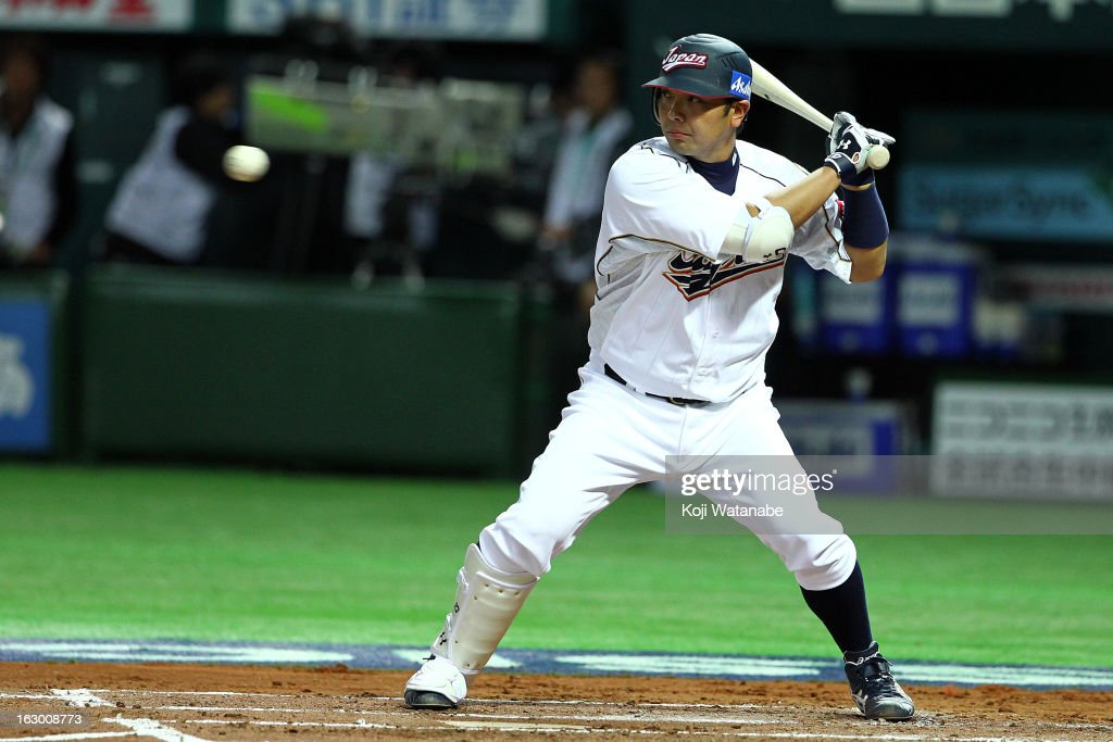 Catcher <a gi-track='captionPersonalityLinkClicked' href=/galleries/search?phrase=Shinnosuke+Abe&family=editorial&specificpeople=2708810 ng-click='$event.stopPropagation()'>Shinnosuke Abe</a> #10 of Japan at bat during the World Baseball Classic First Round Group A game between Japan and China at Fukuoka Yahoo! Japan Dome on March 3, 2013 in Fukuoka, Japan.