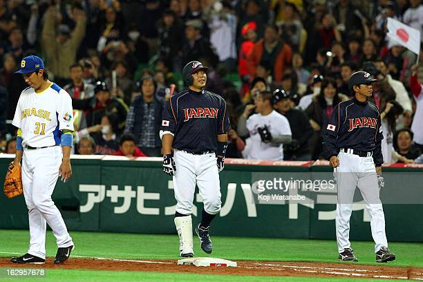 Catcher Shinnosuke Abe of Japan celebrates after scoring in the top half of the eighth inning during the World Baseball Classic First Round Group A...