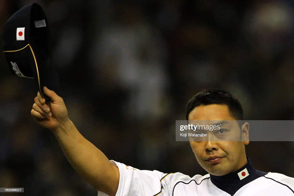 Catcher Shinnosuke Abe #10 of Japan celebrates after winning the World Baseball Classic Second Round Pool 1 game between Japan and the Netherlands at Tokyo Dome on March 12, 2013 in Tokyo, Japan.
