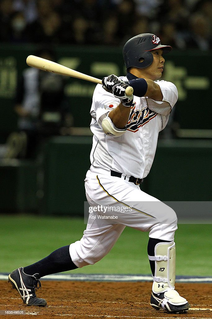 Catcher <a gi-track='captionPersonalityLinkClicked' href=/galleries/search?phrase=Shinnosuke+Abe&family=editorial&specificpeople=2708810 ng-click='$event.stopPropagation()'>Shinnosuke Abe</a> #10 of Japan hits a homer in the bottom half of the second inning during the World Baseball Classic Second Round Pool 1 game between Japan and the Netherlands at Tokyo Dome on March 12, 2013 in Tokyo, Japan.