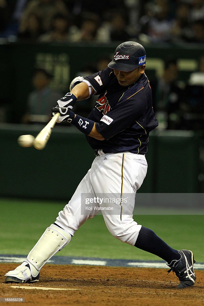 Catcher <a gi-track='captionPersonalityLinkClicked' href=/galleries/search?phrase=Shinnosuke+Abe&family=editorial&specificpeople=2708810 ng-click='$event.stopPropagation()'>Shinnosuke Abe</a> #10 of Japan hits a RBI single in the top half of the eighth inning during the World Baseball Classic Second Round Pool 1 game between Japan and Chinese Taipei at Tokyo Dome on March 8, 2013 in Tokyo, Japan.