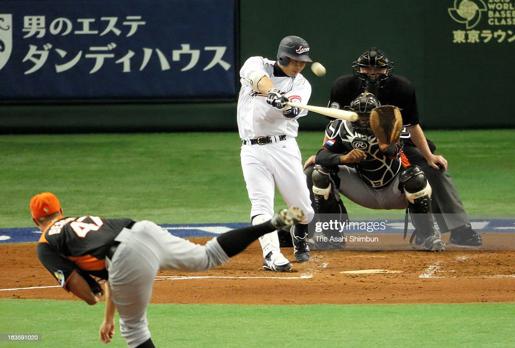 Catcher Shinnosuke Abe #10 of Japan hits a solo homer in the bottom half of the second inning during the World Baseball Classic Second Round Pool 1 game between Japan and the Netherlands at Tokyo Dome on March 12, 2013 in Tokyo, Japan.