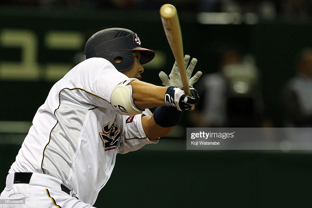 Catcher Shinnosuke Abe #10 of Japan hits a three-run home run in the bottom half of the second inning during the World Baseball Classic Second Round Pool 1 game between Japan and the Netherlands at Tokyo Dome on March 12, 2013 in Tokyo, Japan.