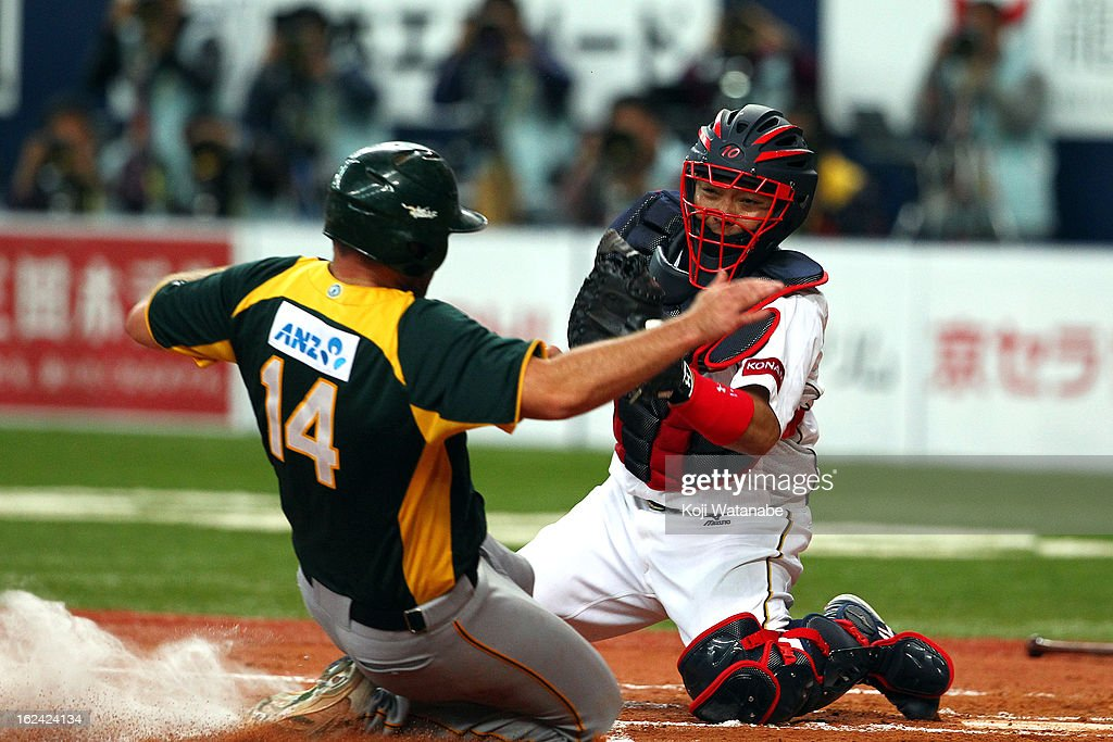 Catcher <a gi-track='captionPersonalityLinkClicked' href=/galleries/search?phrase=Shinnosuke+Abe&family=editorial&specificpeople=2708810 ng-click='$event.stopPropagation()'>Shinnosuke Abe</a> #10 of Japan in action during in the top half of the second inning international friendly game between Japan and Australia at Kyocera Dome Osaka on February 23, 2013 in Osaka, Japan.