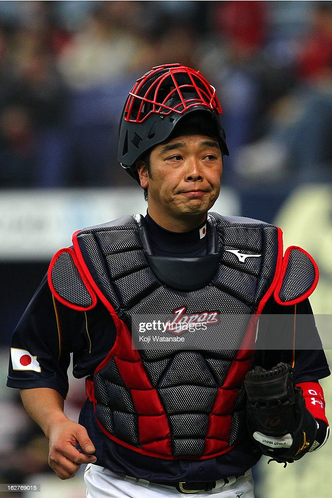 Catcher <a gi-track='captionPersonalityLinkClicked' href=/galleries/search?phrase=Shinnosuke+Abe&family=editorial&specificpeople=2708810 ng-click='$event.stopPropagation()'>Shinnosuke Abe</a> #10 of Japan in action during the friendly game between Hanshin Tigers and Japan at Kyocera Dome Osaka on February 26, 2013 in Osaka, Japan.