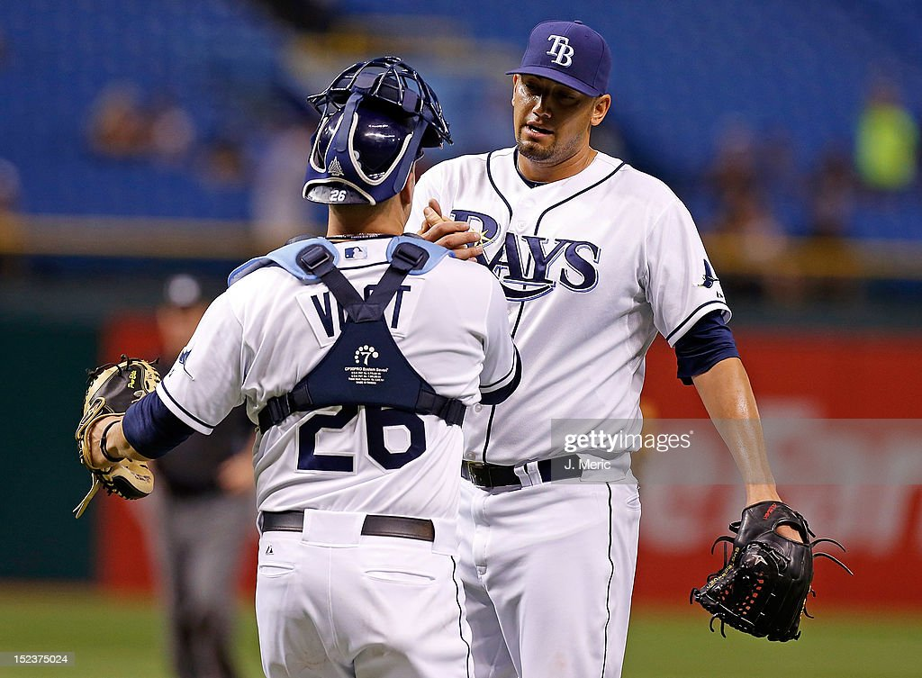 Catcher Stephen Vogt #26 of the Tampa Bay Rays congratulates pitcher Dane De La Rosa #49 after getting the last out against the Boston Red Sox at Tropicana Field on September 19, 2012 in St. Petersburg, Florida.