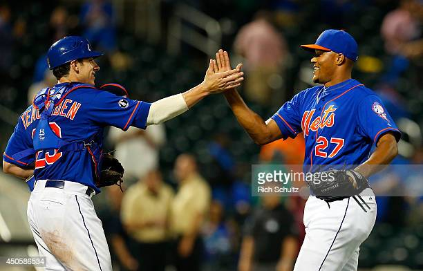 Catcher Taylor Teagarden high fives pitcher Jeurys Familia of the New York after the Mets defeated the San Diego Padres 62 on June 13 2014 at Citi...