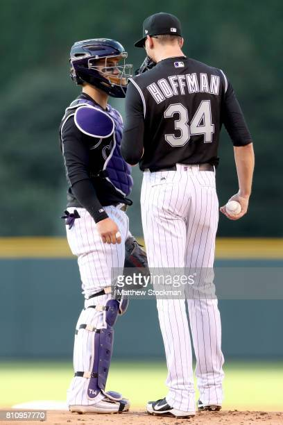 Catcher Tony Wolters confers with starting pitcher Jeff Hoffman of the Colorado Rockies in the first inning against the Chicago White Sox at Coors...