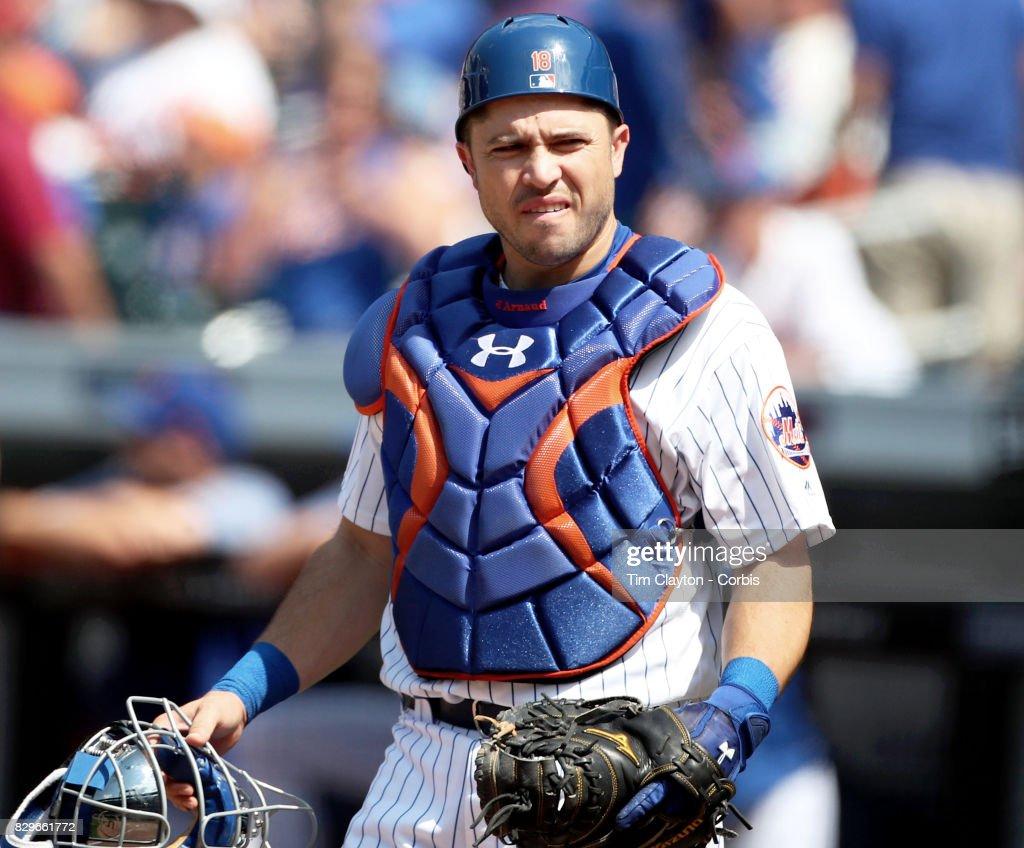 Catcher Travis d'Arnaud #18 of the New York Mets during the Texas Rangers Vs New York Mets regular season MLB game at Citi Field on August 9, 2017 in New York City.