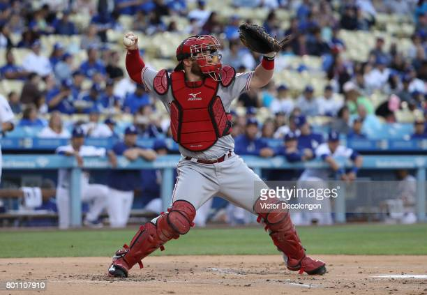 Catcher Tucker Barnhart of the Cincinnati Reds throws to second base in the middle of the first inning of the MLB game against the Los Angeles...