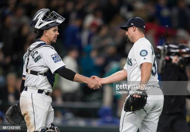 Catcher Tuffy Gosewisch of the Seattle Mariners and relief pitcher Dan Altavilla of the Seattle Mariners celebrated a win over the Texas Rangers...
