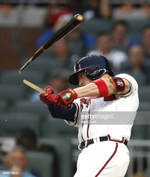 Catcher Tyler Flowers of the Atlanta Braves breaks his bat hitting a single in the second inning during the game against the Pittsburgh Pirates at...