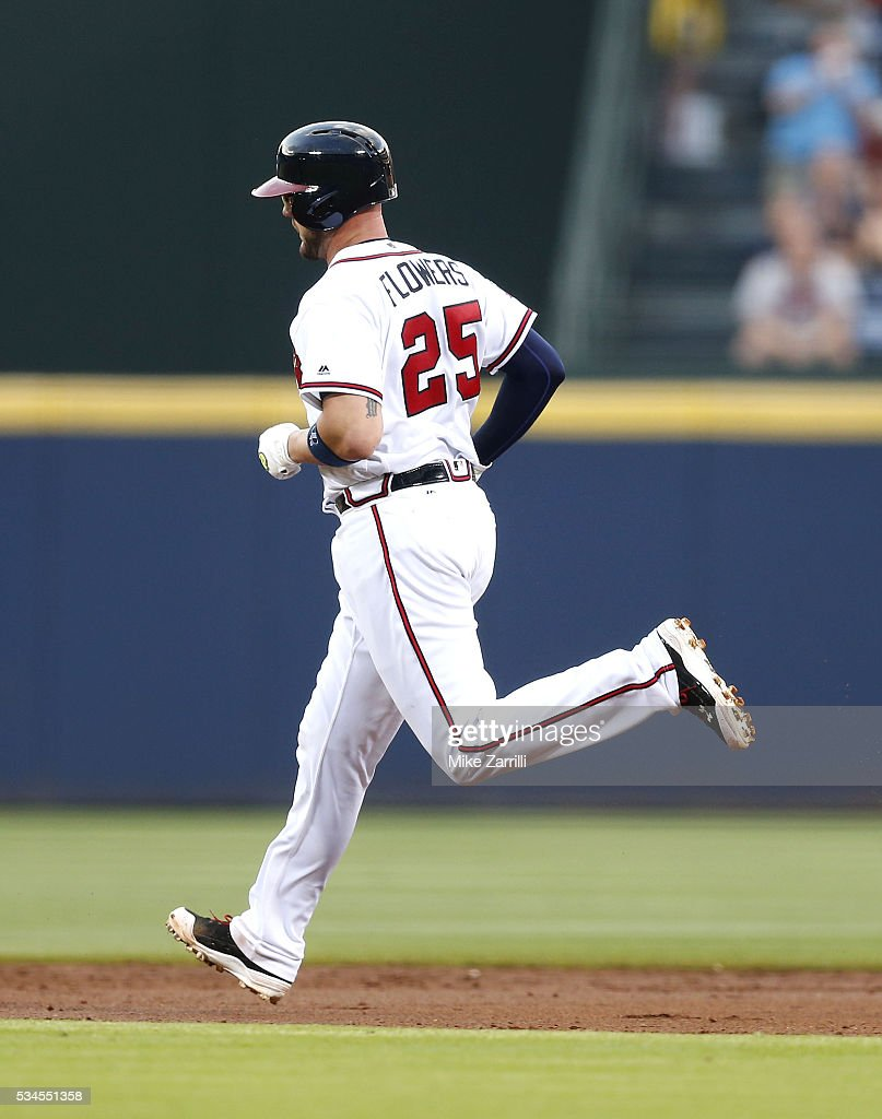Catcher <a gi-track='captionPersonalityLinkClicked' href=/galleries/search?phrase=Tyler+Flowers&family=editorial&specificpeople=4217244 ng-click='$event.stopPropagation()'>Tyler Flowers</a> #25 of the Atlanta Braves rounds the bases on his solo home run in the first inning during the game against the Milwaukee Brewers at Turner Field on May 26, 2016 in Atlanta, Georgia.