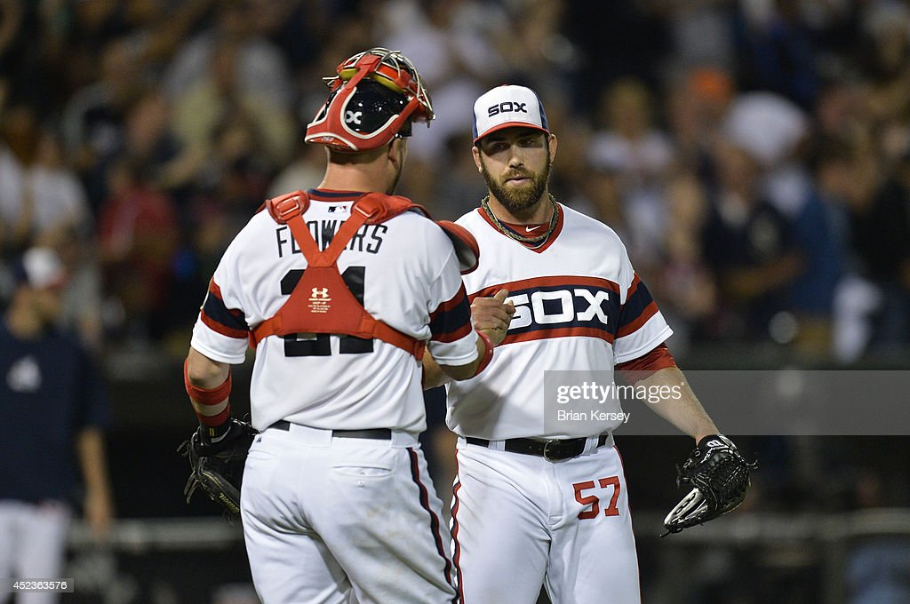 Catcher Tyler Flowers #21 of the Chicago White Sox (L) and relief pitcher Zach Putnam #57 celebrate their win over the Houston Astros at U.S. Cellular Field on July 18, 2014 in Chicago, Illinois. The White Sox defeated the Astros 3-2.