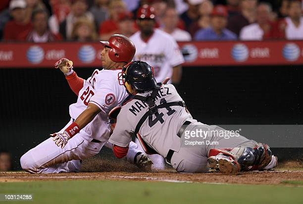 Catcher Victor Martinez of the Boston Red Sox tags out Juan Rivera of the Los Angeles Angels of Anaheim trying to score from third on a ground ball...