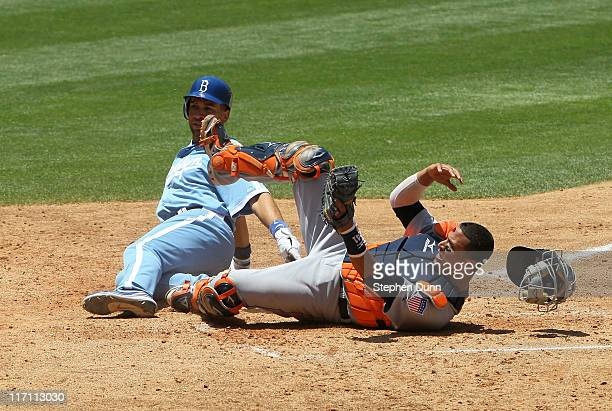 Catcher Victor Martinez of the Detroit Tigers hangs on to the ball after tagging out Jamez Loney of the Los Angeles Dodgers to end theon June 22 2011...