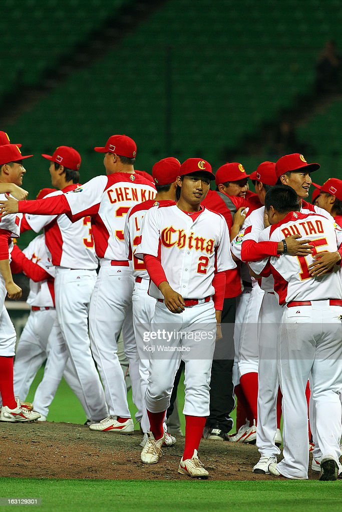 Catcher Weiqiang Meng #2 of China celebrates winning with teammates during the World Baseball Classic First Round Group A game between China and Brazil at Fukuoka Yahoo! Japan Dome on March 5, 2013 in Fukuoka, Japan.