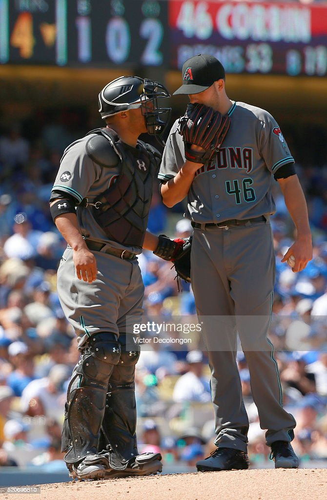 Catcher Welington Castillo of the Arizona Diamondbacks visits the mound and talks with pitcher Patrick Corbin in the fourth inning during the MLB...