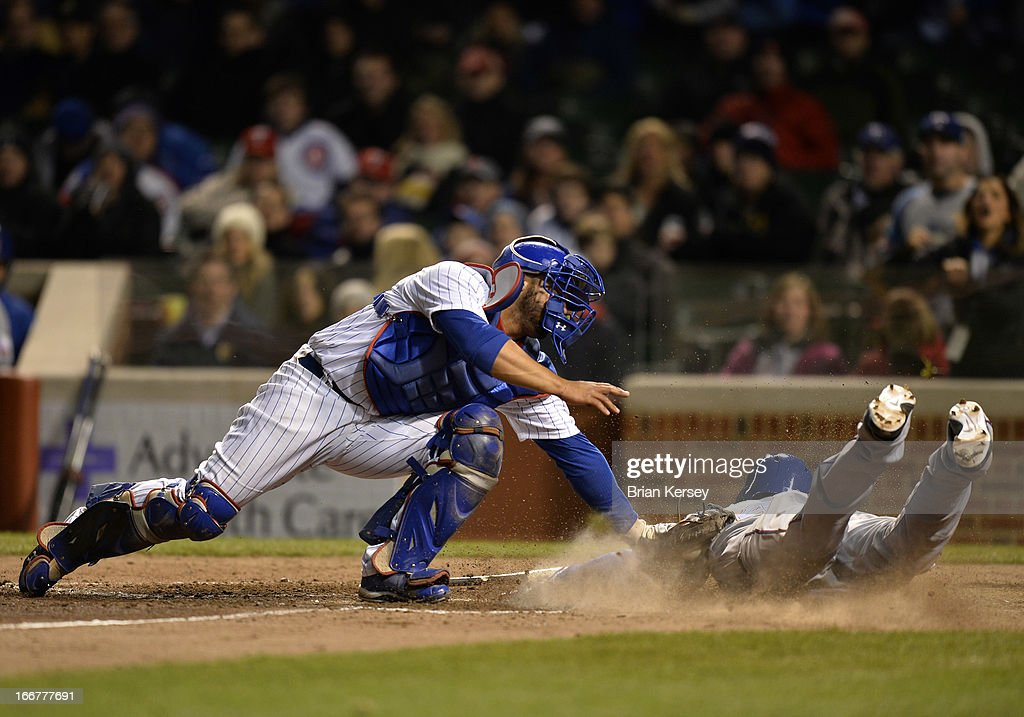 Catcher <a gi-track='captionPersonalityLinkClicked' href=/galleries/search?phrase=Welington+Castillo&family=editorial&specificpeople=4959193 ng-click='$event.stopPropagation()'>Welington Castillo</a> of the Chicago Cubs tags out Craig Gentry of the Texas Rangers at home plate after Gentry tried to score from second base on an infield single by Leonys Martin during the ninth inning at Wrigley Field on April 16, 2013 in Chicago, Illinois. All uniformed team members are wearing jersey number 42 in honor of Jackie Robinson Day.
