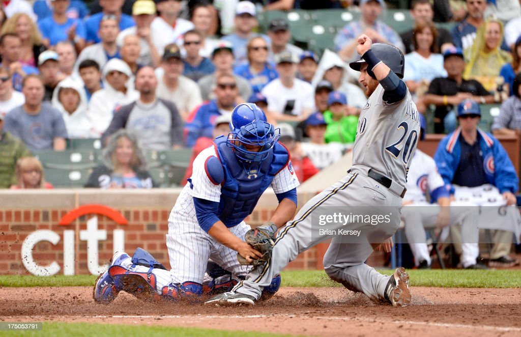 Catcher <a gi-track='captionPersonalityLinkClicked' href=/galleries/search?phrase=Welington+Castillo&family=editorial&specificpeople=4959193 ng-click='$event.stopPropagation()'>Welington Castillo</a> #53 of the Chicago Cubs (L) tags out <a gi-track='captionPersonalityLinkClicked' href=/galleries/search?phrase=Jonathan+Lucroy&family=editorial&specificpeople=5732413 ng-click='$event.stopPropagation()'>Jonathan Lucroy</a> #20 of the Milwaukee Brewers as he tries to score on a fielder's choice ground ball hit by Jeff Bianchi #14 during the fourth inning at Wrigley Field on July 30, 2013 in Chicago, Illinois.