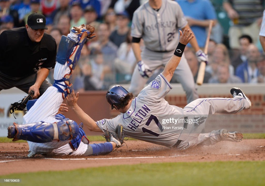 Catcher <a gi-track='captionPersonalityLinkClicked' href=/galleries/search?phrase=Welington+Castillo&family=editorial&specificpeople=4959193 ng-click='$event.stopPropagation()'>Welington Castillo</a> #53 of the Chicago Cubs tags out <a gi-track='captionPersonalityLinkClicked' href=/galleries/search?phrase=Todd+Helton&family=editorial&specificpeople=200735 ng-click='$event.stopPropagation()'>Todd Helton</a> #17 of the Colorado Rockies at home plate after he tried to score on a single hit by Josh Rutledge #14 during the second inning on May 14, 2013 at Wrigley Field in Chicago, Illinois.