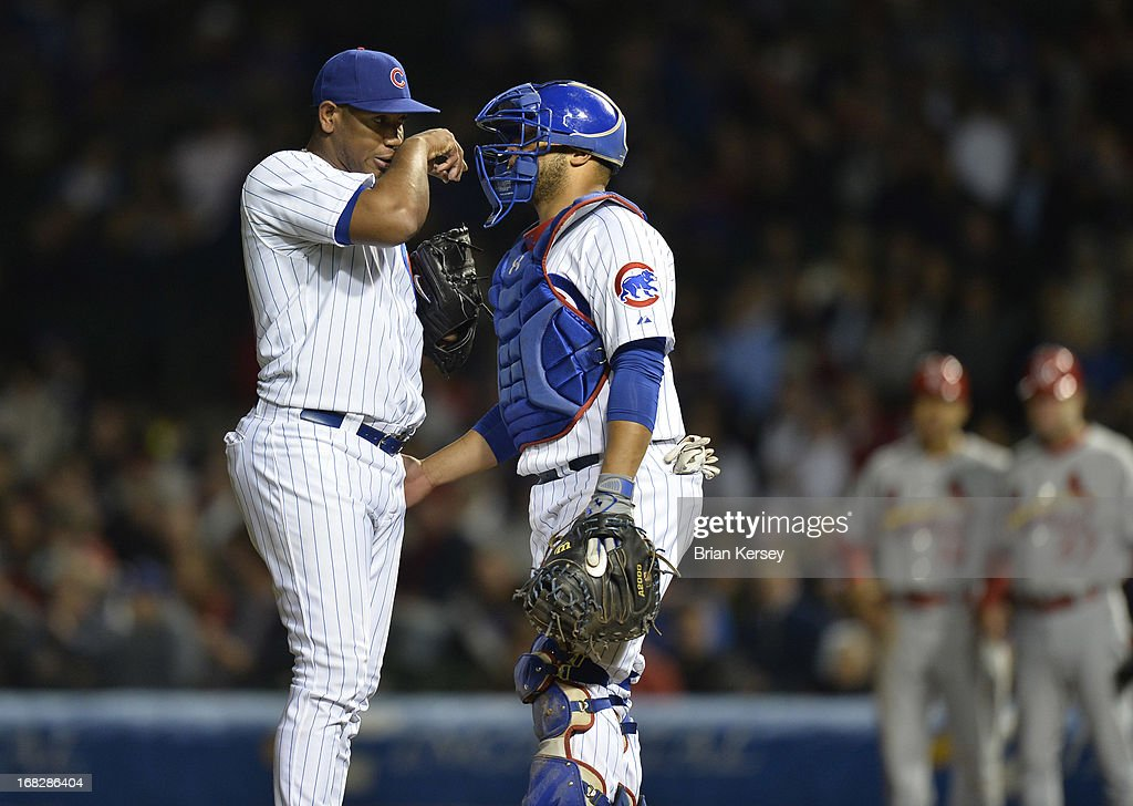 Catcher <a gi-track='captionPersonalityLinkClicked' href=/galleries/search?phrase=Welington+Castillo&family=editorial&specificpeople=4959193 ng-click='$event.stopPropagation()'>Welington Castillo</a> #53 of the Chicago Cubs (R) talks with relief pitcher <a gi-track='captionPersonalityLinkClicked' href=/galleries/search?phrase=Carlos+Marmol&family=editorial&specificpeople=556707 ng-click='$event.stopPropagation()'>Carlos Marmol</a> #49 during the eighth inning against the St. Louis Cardinals on May 7, 2013 at Wrigley Field in Chicago, Illinois.