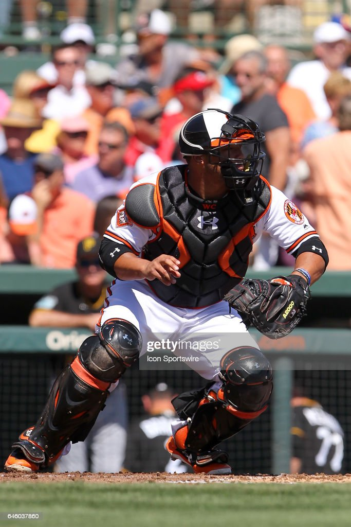 Catcher Wellington Castillo (29) of the Orioles accepts the pitch and then throws the ball down to second base during the spring training game between the Pittsburgh Pirates and the Baltimore Orioles on February 26, 2017 at Ed Smith Stadium in Sarasota, Florida.