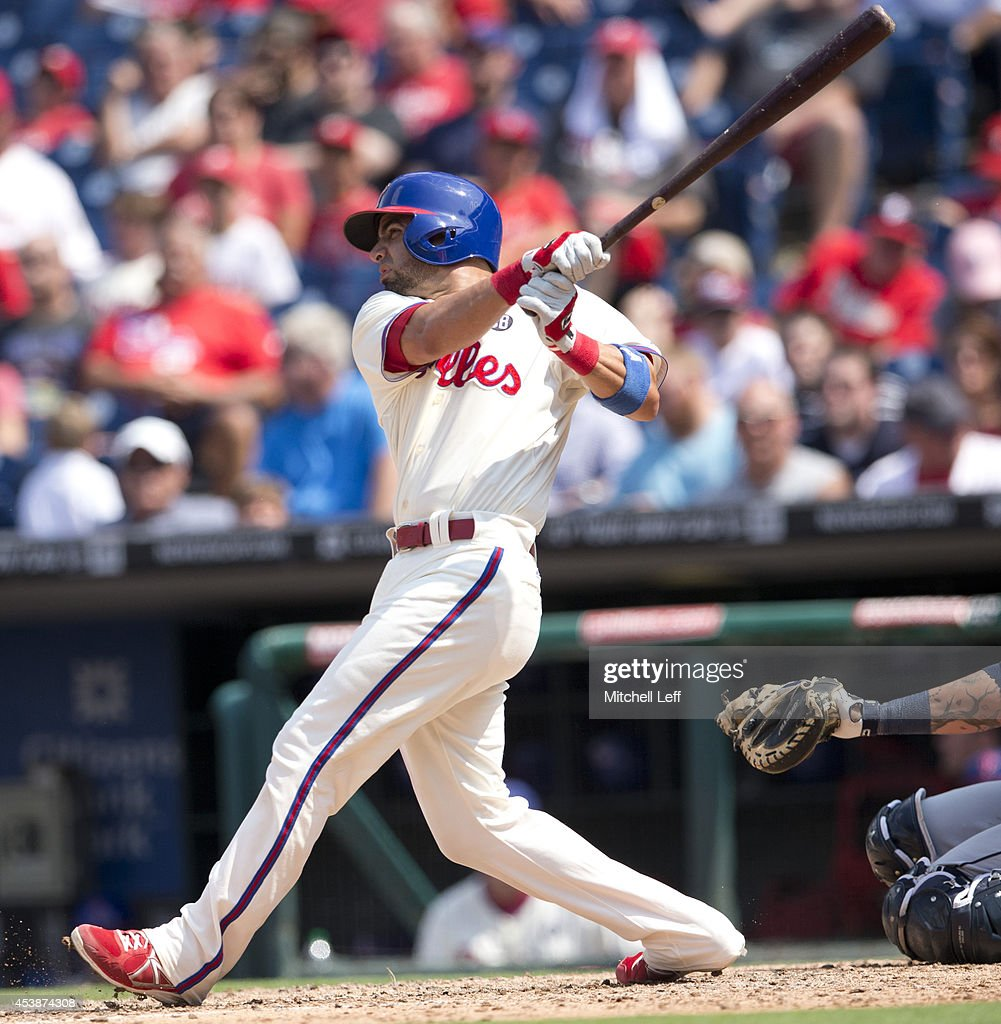 Catcher <a gi-track='captionPersonalityLinkClicked' href=/galleries/search?phrase=Wil+Nieves&family=editorial&specificpeople=835752 ng-click='$event.stopPropagation()'>Wil Nieves</a> #21 of the Philadelphia Phillies hits a single in the bottom of the fourth inning against the Seattle Mariners on August 20, 2014 at Citizens Bank Park in Philadelphia, Pennsylvania.