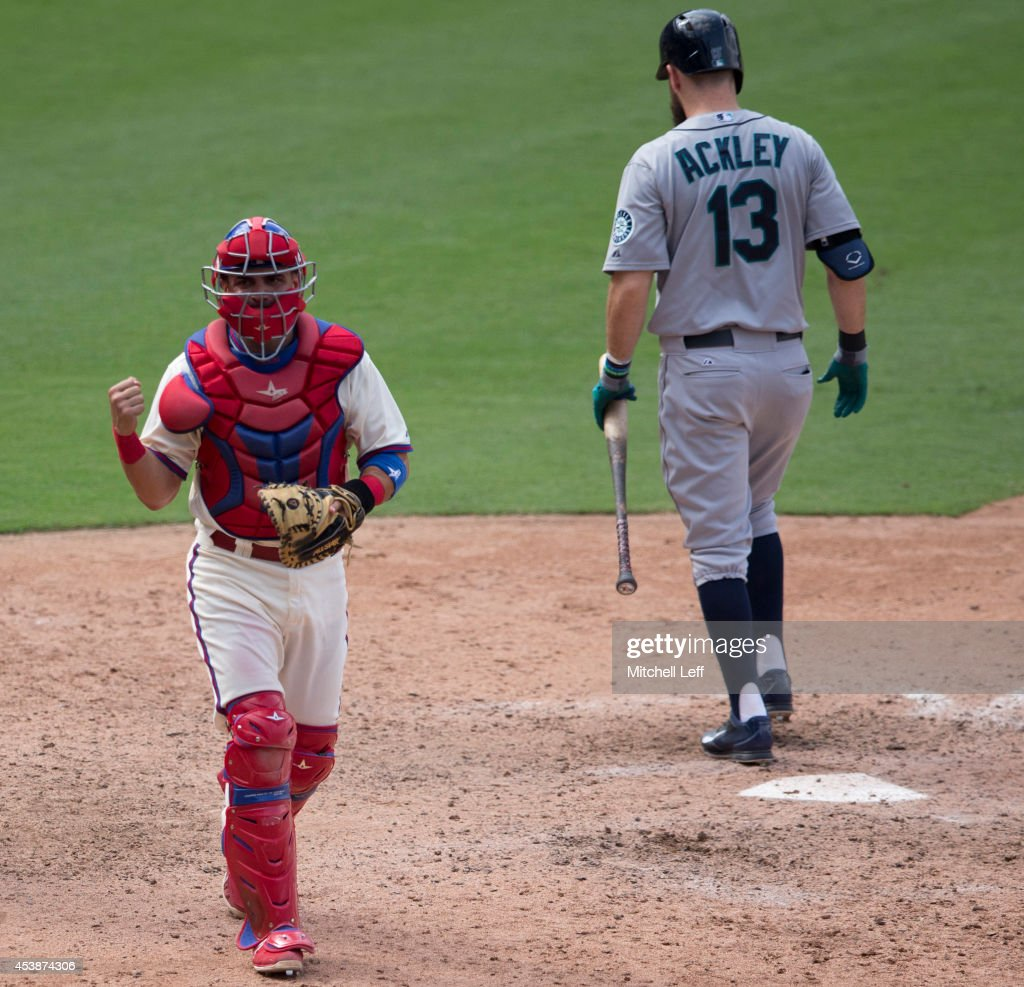 Catcher <a gi-track='captionPersonalityLinkClicked' href=/galleries/search?phrase=Wil+Nieves&family=editorial&specificpeople=835752 ng-click='$event.stopPropagation()'>Wil Nieves</a> #21 of the Philadelphia Phillies reacts after outfielder <a gi-track='captionPersonalityLinkClicked' href=/galleries/search?phrase=Dustin+Ackley&family=editorial&specificpeople=4352278 ng-click='$event.stopPropagation()'>Dustin Ackley</a> #13 of the Seattle Mariners strikes out to end the top of the eighth inning on August 20, 2014 at Citizens Bank Park in Philadelphia, Pennsylvania.