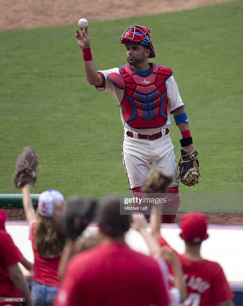 Catcher <a gi-track='captionPersonalityLinkClicked' href=/galleries/search?phrase=Wil+Nieves&family=editorial&specificpeople=835752 ng-click='$event.stopPropagation()'>Wil Nieves</a> #21 of the Philadelphia Phillies throws a ball in the stands after the top of the eighth inning against the Seattle Mariners on August 20, 2014 at Citizens Bank Park in Philadelphia, Pennsylvania.
