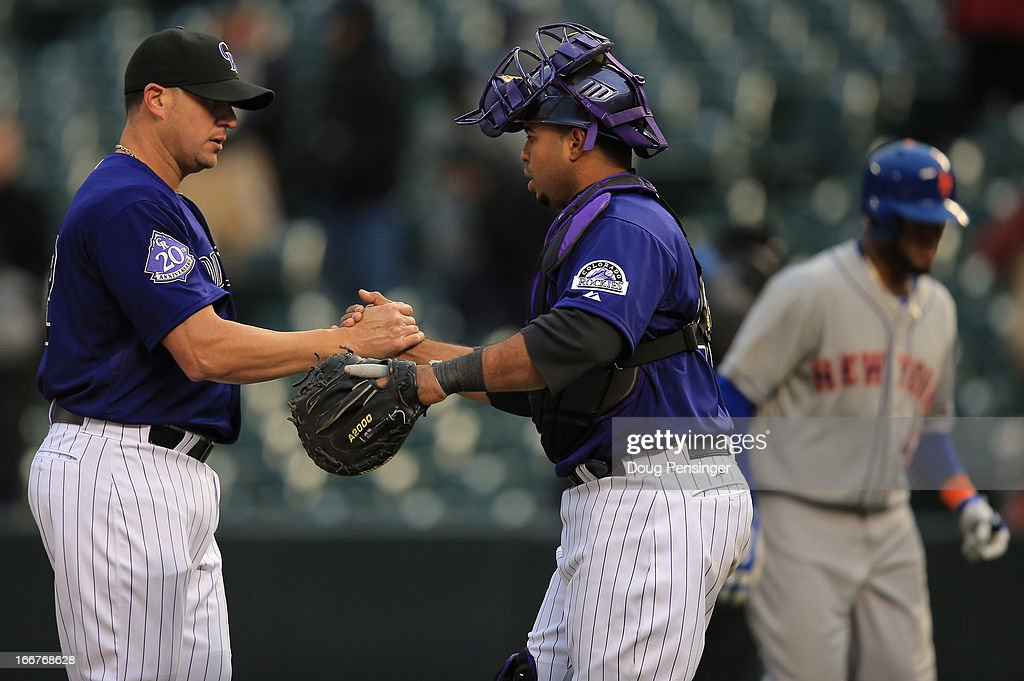 Catcher <a gi-track='captionPersonalityLinkClicked' href=/galleries/search?phrase=Wilin+Rosario&family=editorial&specificpeople=5734314 ng-click='$event.stopPropagation()'>Wilin Rosario</a> and relief pitcher <a gi-track='captionPersonalityLinkClicked' href=/galleries/search?phrase=Rafael+Betancourt&family=editorial&specificpeople=224728 ng-click='$event.stopPropagation()'>Rafael Betancourt</a> #63 of the Colorado Rockies celebrate as they defeated the New York Mets 8-4 in the first game of a double header at Coors Field on April 16, 2013 in Denver, Colorado. All uniformed team members are wearing jersey number 42 in honor of Jackie Robinson Day.
