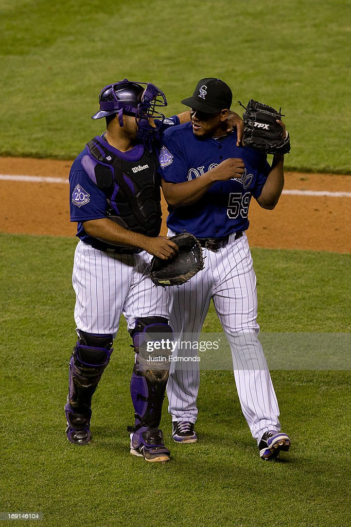 Catcher <a gi-track='captionPersonalityLinkClicked' href=/galleries/search?phrase=Wilin+Rosario&family=editorial&specificpeople=5734314 ng-click='$event.stopPropagation()'>Wilin Rosario</a> #20 and relief pitcher <a gi-track='captionPersonalityLinkClicked' href=/galleries/search?phrase=Wilton+Lopez&family=editorial&specificpeople=4901786 ng-click='$event.stopPropagation()'>Wilton Lopez</a> #59 walk off the field together in the middle of the ninth inning against the Arizona Diamondbacks at Coors Field on May 20, 2013 in Denver, Colorado. The Diamondbacks defeated the Rockies 5-1.