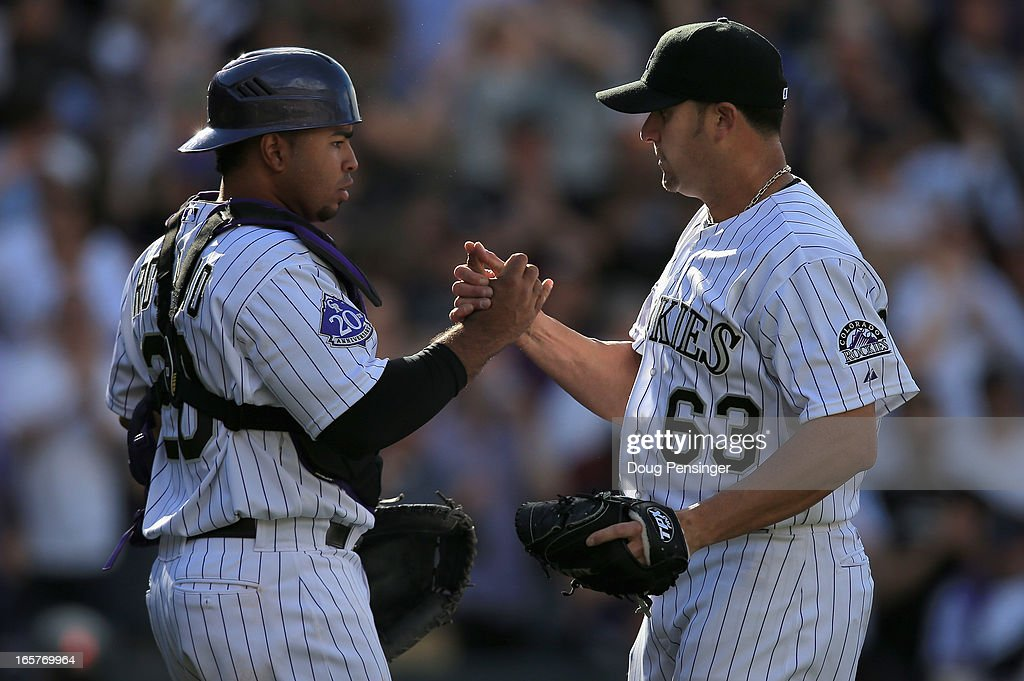 Catcher Wilin Rosario #20 of the Colorado Rockies and pitcher Rafael Betancourt #63 of the Colorado Rockies celebrate their victory over the San Diego Padres during Opening Day at Coors Field on April 5, 2013 in Denver, Colorado. The Rockies defeated the Padres 5-2.