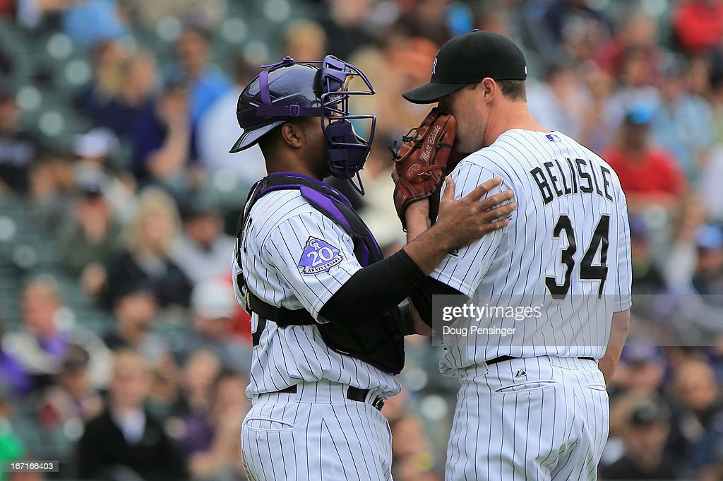 Catcher <a gi-track='captionPersonalityLinkClicked' href=/galleries/search?phrase=Wilin+Rosario&family=editorial&specificpeople=5734314 ng-click='$event.stopPropagation()'>Wilin Rosario</a> #20 of the Colorado Rockies and relief pitcher <a gi-track='captionPersonalityLinkClicked' href=/galleries/search?phrase=Matt+Belisle&family=editorial&specificpeople=666580 ng-click='$event.stopPropagation()'>Matt Belisle</a> #34 of the Colorado Rockies talk as they face the Arizona Diamondbacks at Coors Field on April 21, 2013 in Denver, Colorado. The Diamondbacks defeated the Rockies 5-4.