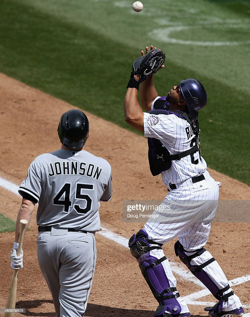 Catcher Wilin Rosario #20 of the Colorado Rockies catches a pop foul bunt by pitcher Erik Johnson #45 of the Chicago White Sox in the second inning during Interleague play at Coors Field on April 9, 2014 in Denver, Colorado.