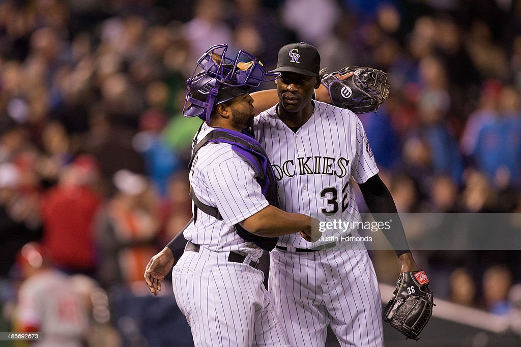 Catcher <a gi-track='captionPersonalityLinkClicked' href=/galleries/search?phrase=Wilin+Rosario&family=editorial&specificpeople=5734314 ng-click='$event.stopPropagation()'>Wilin Rosario</a> #20 of the Colorado Rockies celebrates with relief pitcher LaTroy Hawkins #32 after they defeated the Philadelphia Phillies 3-1 at Coors Field on April 19, 2014 in Denver, Colorado.