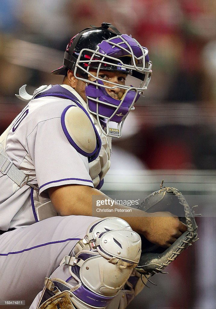 Catcher <a gi-track='captionPersonalityLinkClicked' href=/galleries/search?phrase=Wilin+Rosario&family=editorial&specificpeople=5734314 ng-click='$event.stopPropagation()'>Wilin Rosario</a> #20 of the Colorado Rockies in action during the MLB game against the Arizona Diamondbacks at Chase Field on October 2, 2012 in Phoenix, Arizona. The Diamondbacks defeated the Rockies 5-3.